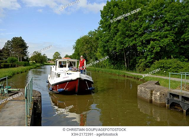 houseboat approaching a lock of Canal du Centre around Chagny, Saone-et-Loire department, Burgundy region, France, Europe