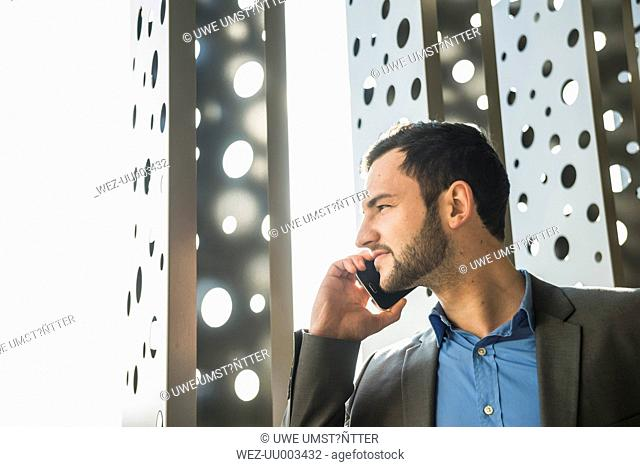 Young businessman on cell phone