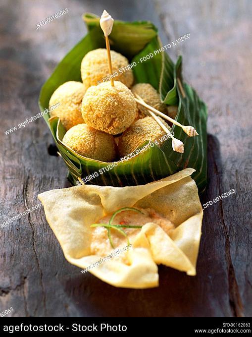 Potato and shrimp balls with lime and chili sauce