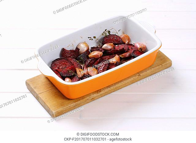 freshly baked beetroot with garlic in baking dish