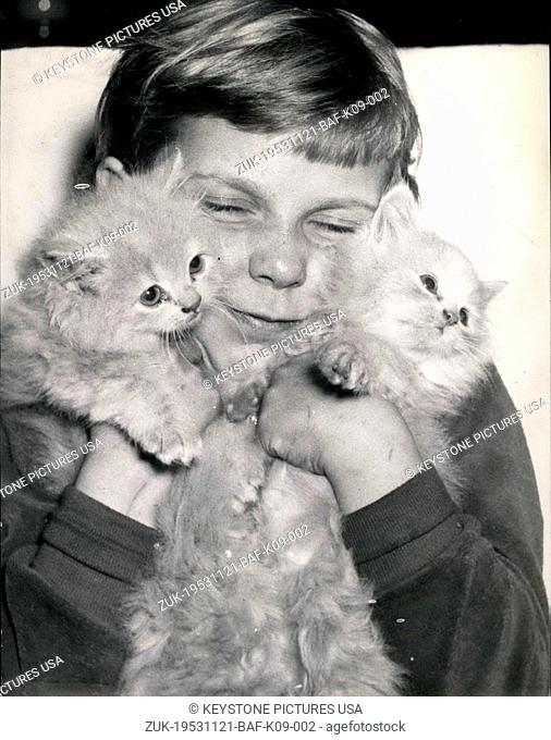 Nov. 21, 1953 - These little Angora kitties aren't comfortable with so much love from a kid! These little guys are part of the first German Exhibition on Cats...