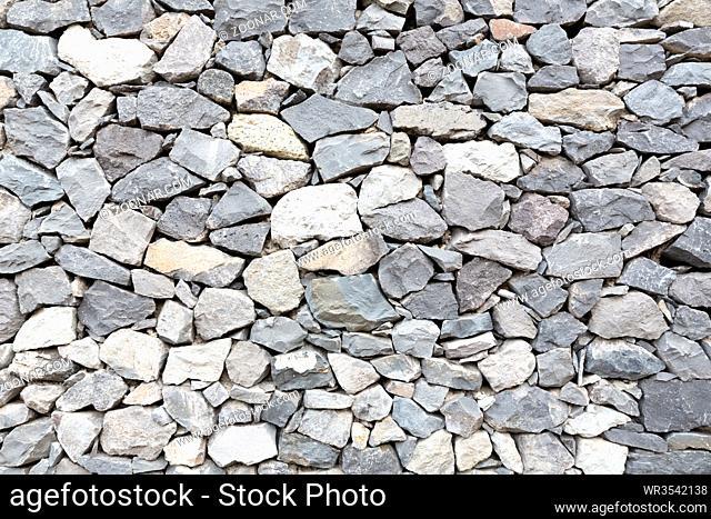 Graue Steinmauer als Hintergrund