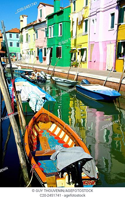 Colored Fishing boats, canal, Drying clothes, colored facades, Burano island, Venice, Venetia, Italy