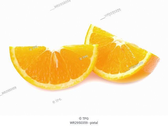 piece of fresh orange fruit with shadow on white background