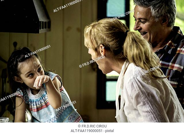 Girl with her grandparents in kitchen