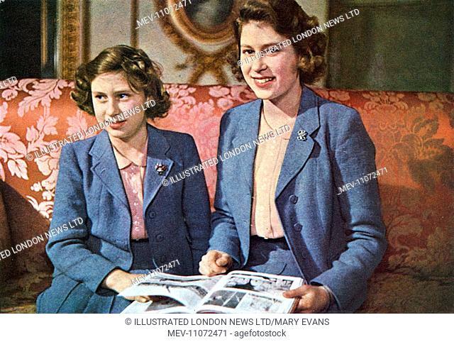 Princess Elizabeth, later Queen Elizabeth II (1926 - ) and her younger sister Princess Margaret Rose (1930 - 2002) pictured together
