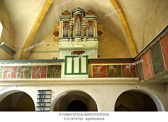 Organ & saon folk art of the Gothic interior of the 14th Century Axente Sever Fortified Church, Transylvania