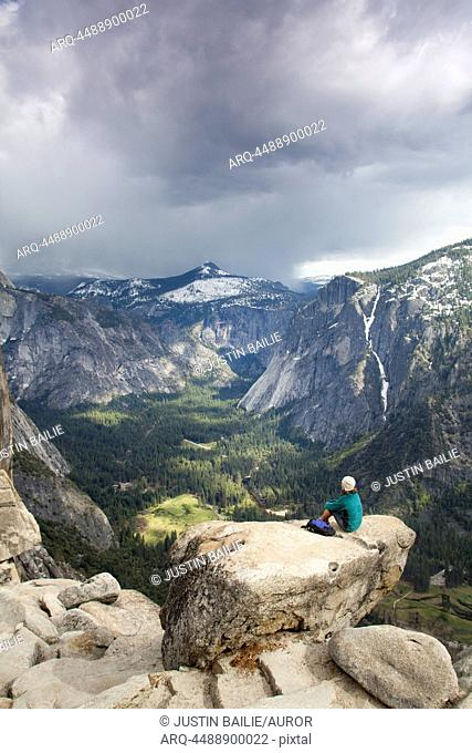 Young woman hiking the Yosemite Falls trail. Yosemite National Park, CA
