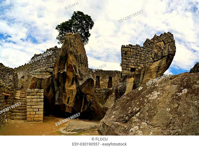 Close up view of a sun god temple in in Machu Picchu. Machu Picchu is the famous lost city of the Incas near the river Urubamba located in the region of the...