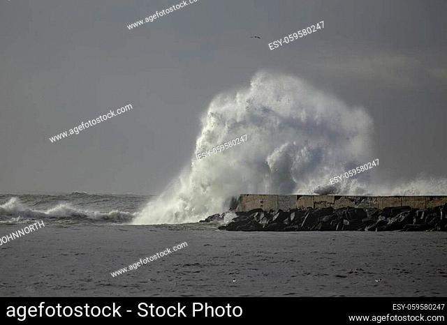 Big stormy wave splash. Ave river north pier, Portugal