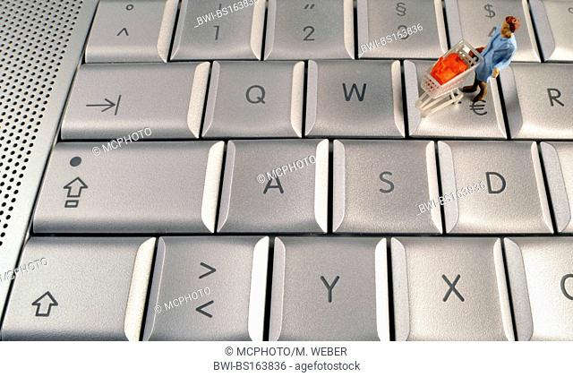 small figure with trolley on keyboard