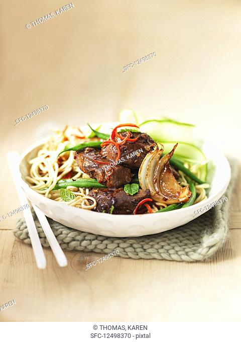 Noodles with lamb, green beans, mint, chilli, and cucumbers
