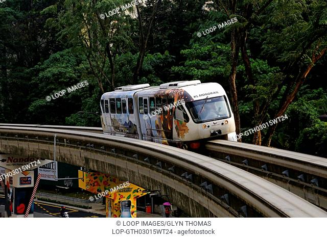 Monorail train travels along the track in central Kuala Lumpur