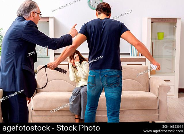 Old judge and young couple in domestic violence concept