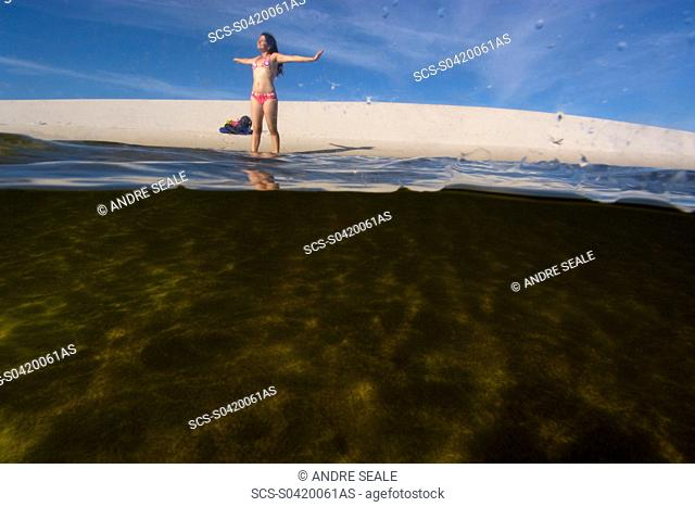 Tourist enjoys the lake in the Lencois Maranhenses National Park, Santo Amaro, Maranh+o, Brazil rr