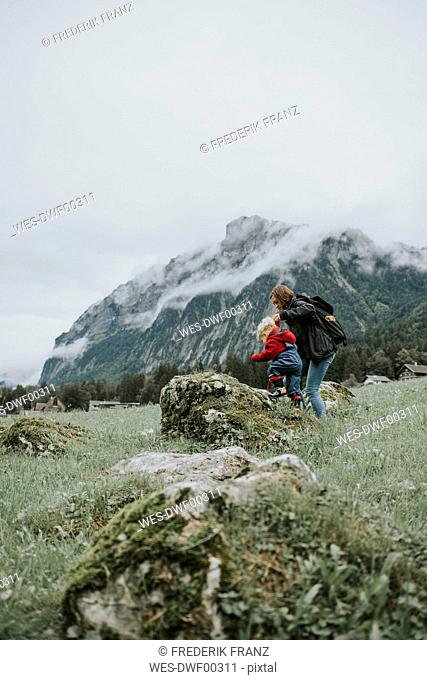 Austria, Vorarlberg, Mellau, mother and toddler on a trip in the mountains