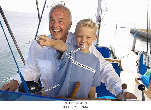 Grandfather and grandson on boat