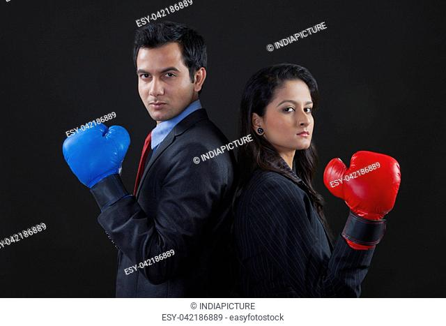 Businessman and businesswoman boxing