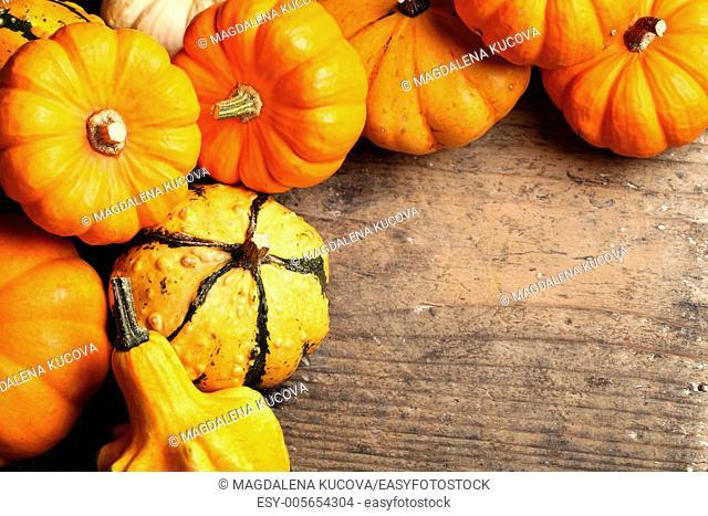 Pumpkins frame on wooden table