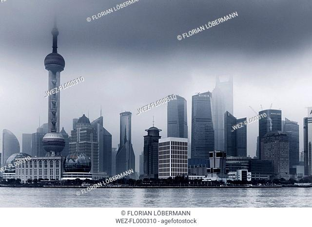 China, Shanghai, Financial District with dramatic sky