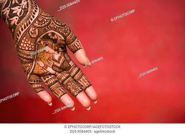 Mehndi on woman's hand. Pune, Maharashtra, India