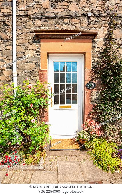 Beautiful flowers and old window in the Scottish village