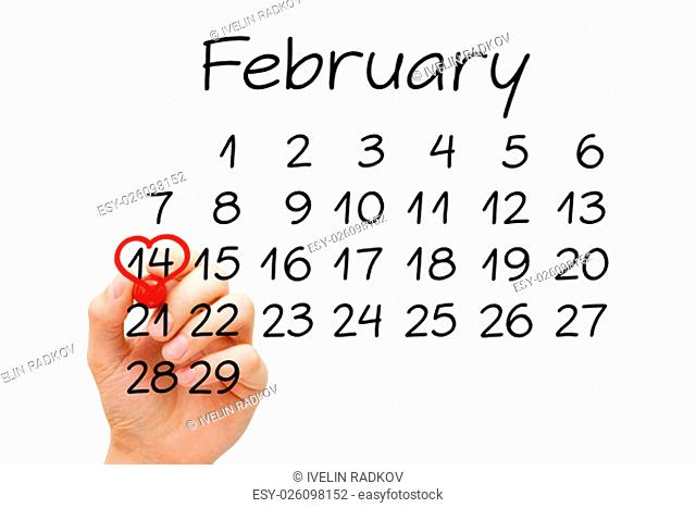Hand drawing heart on February 14 on calendar with red marker on transparent wipe board. Valentines Day concept