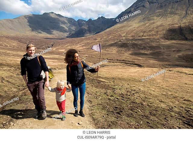 Family hiking in mountains, Fairy Pools, Isle of Skye, Hebrides, Scotland