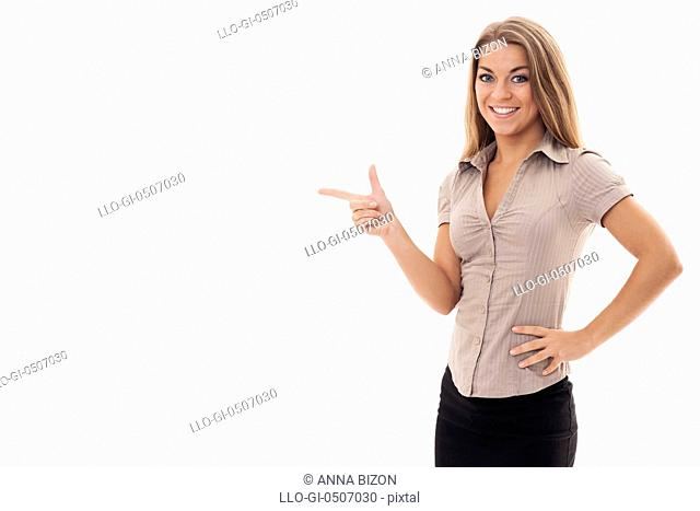 Beautiful businesswoman pointing at copyspace, Debica, Poland