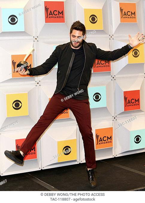 Recording artist, Thomas Rhett, winner of Single Record of the Year for 'Die a Happy Man,' poses in the press room during the 51st Academy of Country Music...