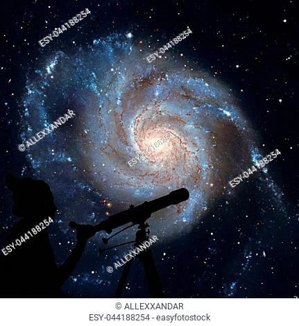 Girl looking at the stars with telescope. Pinwheel Galaxy Messier 101, M101 in the constellation Ursa MajorElements of this image are furnished by NASA