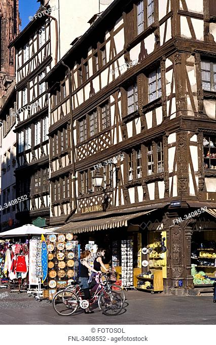 Cyclists in front of a gift shop, Strasbourg, France