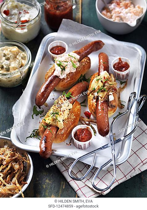 Hot dogs with crab salad, remoulade sauce, and roasted onions