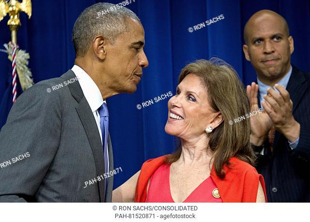 United States President Barack Obama and Bonnie Lautenberg, widow of US Senator Frank Lautenberg (Democrat of New Jersey) prior to his signing H.R