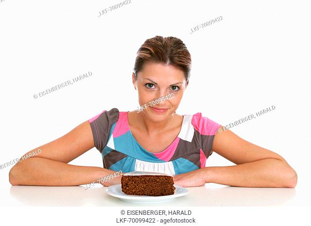 Mid adult woman with a piece of chocolate cake, Styria, Austria
