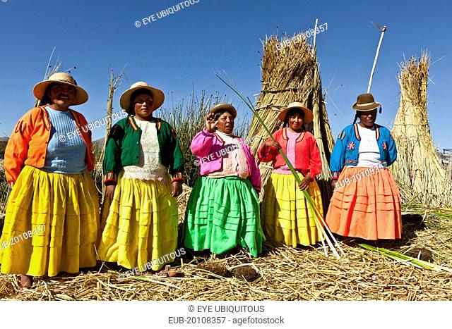 Lake Titicaca Women in colorful clothing on Grass Island