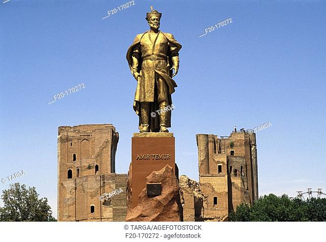 Statue of Tamerlane and ruins of the Ak-Saray Palace. Shakhrisabz. Uzbekistan