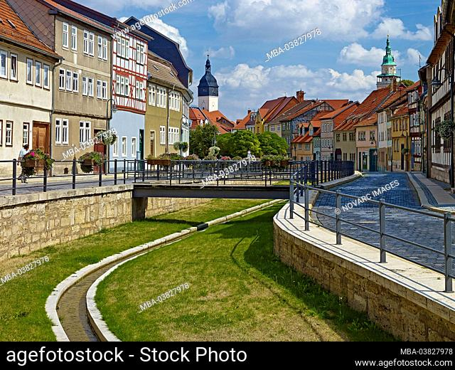 Long street with town hall tower and church tower of Bonifatiuskirche in Bad Langensalza, Thuringia, Germany