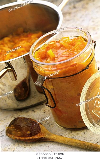 Tomato and onion relish in a preserving jar and a pot