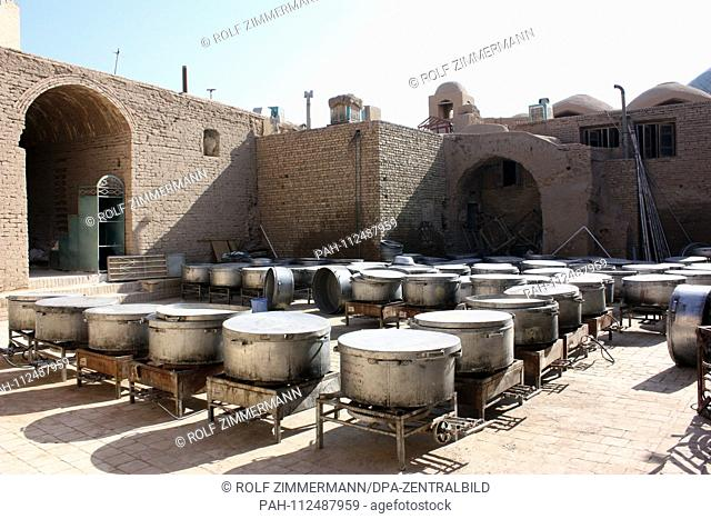 Iran - Yazd, also Jasd, is one of the oldest cities of Iran and capital of the province of the same name. View into a courtyard with cauldrons serving food...