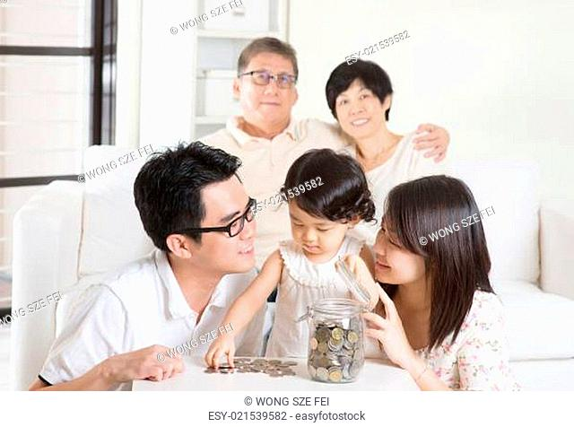 Asian family money savings concept. Multi generations living lifestyle at home