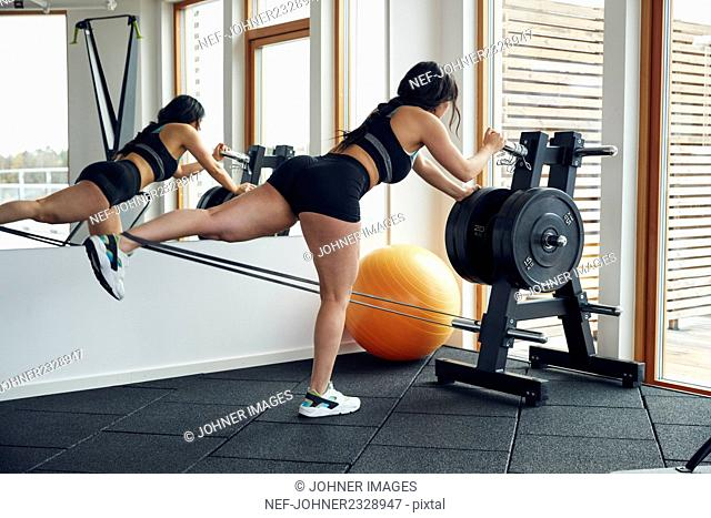 Woman excercising in gym