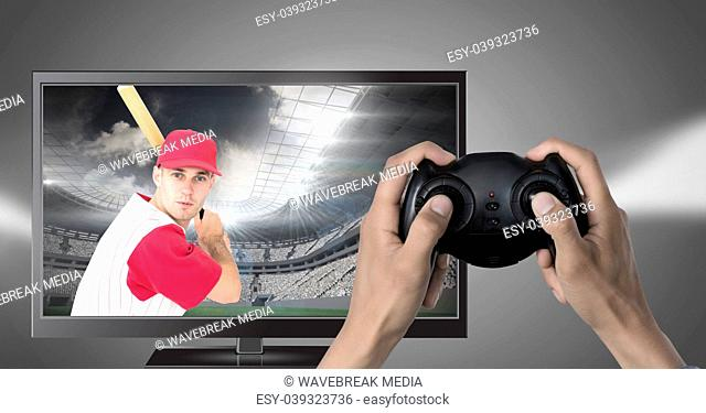 Hands holding gaming controller with baseball player on television