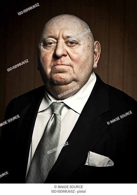 Studio portrait of confident senior man