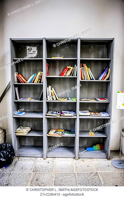 Bookcase of books for an outside public garden in Udine Italy