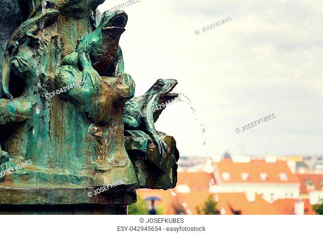 Frog splashing water on fountain, water scarcity concept, Petrin, Prague