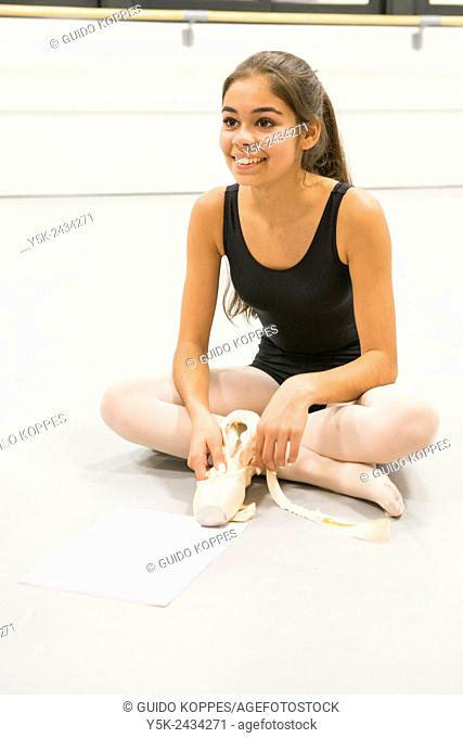 Den Bosch, 's-Hertogenbosch, Netherlands. Teenage schoolgirl practising classica ballet at a local balletstudio