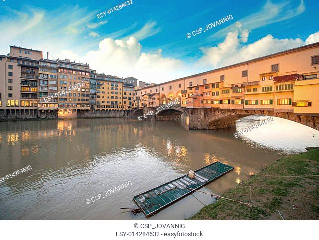 Wonderful sunset colors in Florence with Arno River and Ponte Vecchio Bridge