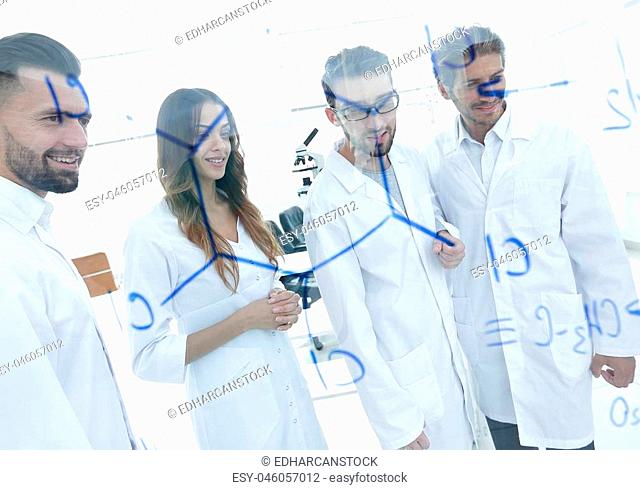 group of laboratory employees.Molecular Structure Chemistry Science Experiment Concept