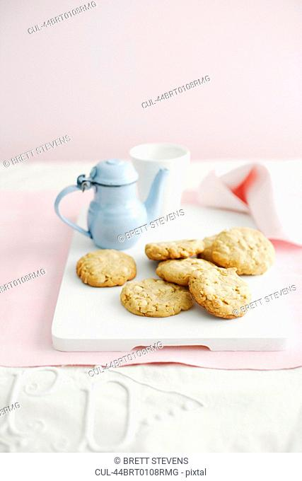 Plate of cookies with cup of tea
